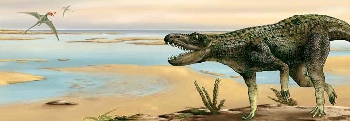Reconstrucción de un paisaje del Triásico con reptil rausuchio y pterosaurio al fondo